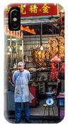Shop Owner Standing In Front Of Poultry Shop On Temple Street Night Market Kowloon Hong Kong China IPhone Case