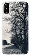 Bleak, Barren Trees Lining A Vacant Street IPhone Case