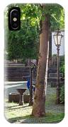 tree lamp and old water pump in Cochem Germany IPhone Case
