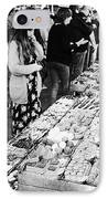 people buying chocolates on display inside the la boqueria market in Barcelona Catalonia Spain IPhone Case