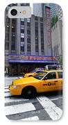 Yellow Cabs Pass In Front Of Radio City Music Hall IPhone Case by Amy Cicconi