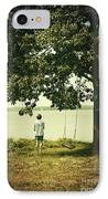 Young Boy Looking Out At The Water Under A Big Tree IPhone Case