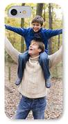 Father Carrying His Son In A Wood IPhone Case by Ian Boddy