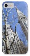 Looking Up Through Trees At Skyscrapers IPhone Case by Axiom Photographic