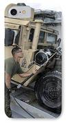 Marine Uses A Pressure Washer To Clean IPhone Case by Stocktrek Images