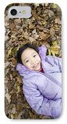 Smiling Girl Lying On Autumn Leaves IPhone Case