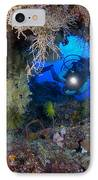 A Diver Peers Through A Coral Encrusted IPhone Case