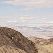 A Hiker Stands On A Peak Poster