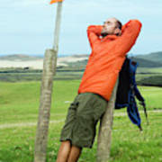 A Man Enjoying A Moment Of Rest Poster