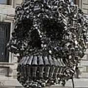 A Skull Sculpture Made Of Cans And Metal Along The Grand Canal Poster