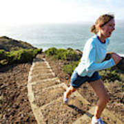 A Woman Running Stairs Near The Ocean Poster