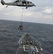 An Mh-60s Sea Hawk Helicopter Delivers Poster