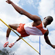 Athlete Performing A High Jump Poster