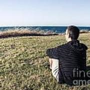 Caucasian Traveler Relaxing On Grass Outdoors Poster