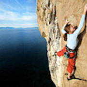 Climber Grabs A Hold While Climbing Poster
