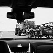 driving behind combine harvester on road in Saskatchewan Canada Poster