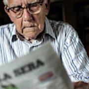 Elderly Man Reading A Newspaper Poster
