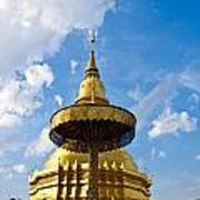 Golden Pagoda With Blue Sky At Wat Phra That Hariphunchai Poster