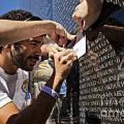 Man Getting A Rubbing Of Fallen Soldier's Name At The Vietnam War Memorial Poster