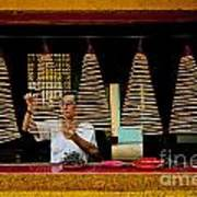 Man Lighting Incense In Chinese Temple Vietnam Poster