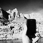 man taking photos with smartphone during boat ride along the colorado river in the grand canyon Ariz Poster