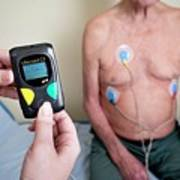 Portable Ecg Monitor Being Fitted Poster