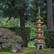 Stone Lantern Illuminated With Candles Poster