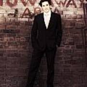 Vintage Salesman Standing In Front Of Brick Wall Poster
