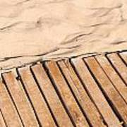 Weathered Wooden Boardwalk On Sand Poster