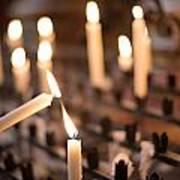Woman Lighting Prayer Candle Poster