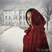 Young Woman Wearing Hooded Cape In Snowy Winter Scene Poster