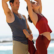 A Man And Woman Practicing Yoga Poster