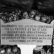 A Marker With Skulls And Bones In The Catacombs Of Paris France Poster