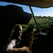 A Woman Sits In Her Safari Jeep Poster