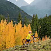 A Young Girl Mountain Biking In The San Poster