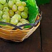 Basket Of Grapes On Rustic Wooden Table Poster
