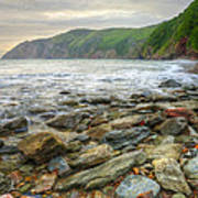 Beautiful Warm Vibrant Sunrise Over Ocean With Cliffs And Rocks Poster