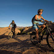 Couple Mountain Biking, Moab, Utah Poster