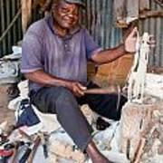 Kenya. December 10th. A Man Carving Figures In Wood. Poster