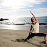 A Women At The Beach Performing Yoga Poster