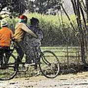 3 Young Children On A Cycle At The Side Of The Road Poster