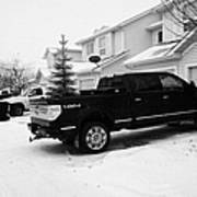 4x4 Pickup Trucks Parked In Driveway In Snow Covered Residential Street During Winter Saskatoon Sask Poster