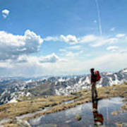 A Backpacker Stands Atop A Mountain Poster