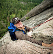 A Climber Reaches His Hand In A Crack Poster