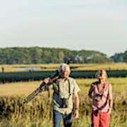 A Couple Bird Watching On A Salt Marsh Poster