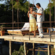 A Couple Having Drinks On A Deck Poster