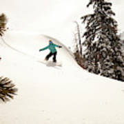 A Female Snowboarder Lays Out Some Poster