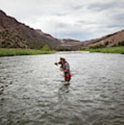 A Fly Fisherman Mends While Fishing Poster