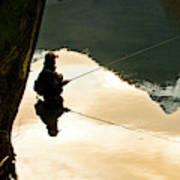 A Fly Fisherman Standing In A River Poster