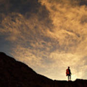 A Hiker Standing On A Ridge At Sun Rise Poster